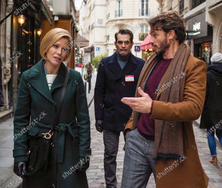 Julie Bowen as Claire Dunphy, Ty Burrell as Phil Dunphy and Arnaud Binard as Guy