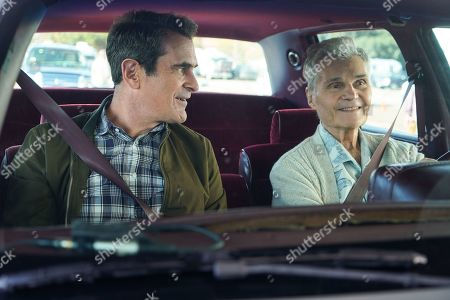 Stock Image of Ty Burrell as Phil Dunphy and Fred Willard as Frank Dunphy