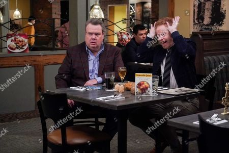 Stock Picture of Eric Stonestreet as Cameron Tucker and Jesse Tyler Ferguson as Mitchell Pritchett