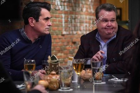 Ty Burrell as Phil Dunphy and Eric Stonestreet as Cameron Tucker