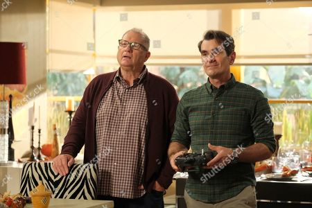 Stock Photo of Ed O'Neill as Jay Pritchett and Ty Burrell as Phil Dunphy