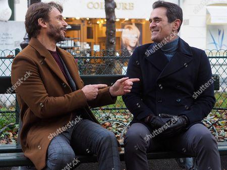 Arnaud Binard as Guy and Ty Burrell as Phil Dunphy