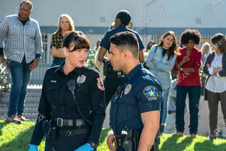 Liv Tyler as Michelle Blake and Rafael Silva as Carlos Reyes