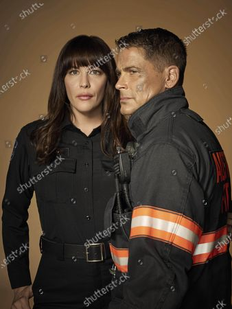 Stock Photo of Liv Tyler as Michelle Blake and Rob Lowe as Owen Strand