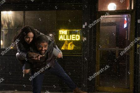 Zoe Kravitz as Robyn 'Rob' Brooks and Kingsley Ben-Adir as Russell 'Mac' McCormack