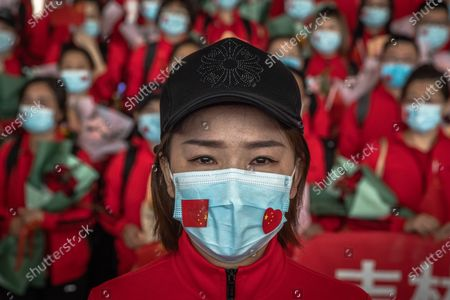 Stock Photo of A medical worker from The First Bethune Hospital of Jilin University reacts at the airport as she prepares to leave after the lockdown was lifted, in Wuhan, China, 08 April 2020. Wuhan, the epicenter of the coronavirus outbreak, lifted the lockdown on 08 April 2020, allowing people to leave the city after more than two months. According to Chinese government figures, over 2,500 people have died of Covid-19 in Wuhan since the outbreak began.