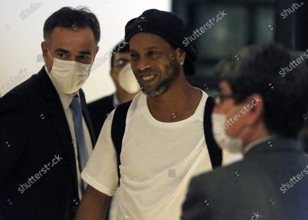 Former Brazilian soccer star Ronaldinho arrives at a hotel where he is to stay under house arrest in Asuncion, Paraguay, . Ronaldinho and his brother Roberto De Assis Moreira spent a month in jail accused of entering Paraguay with fake passports