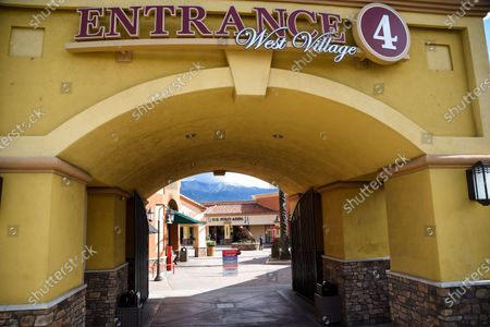 Stock Picture of Few customers at the retail stores at the outdoor mall Cabazon Outlets are open but largely empty due to Covid-19 Corona virus in Cabazon, California John Green/CSM