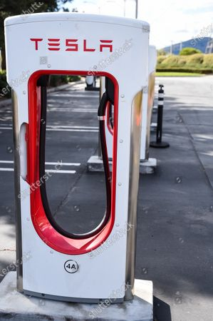 Stock Photo of Tesla charging stations sit unused at retail stores at the outdoor mall Cabazon Outlets are open but largely empty due to Covid-19 Corona virus in Cabazon, California John Green/CSM