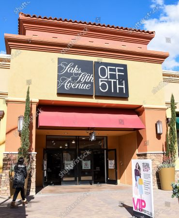 Few customers at Saks Fifth Avenue retail stores at the outdoor mall Cabazon Outlets are open but largely empty due to Covid-19 Corona virus in Cabazon, California John Green/CSM