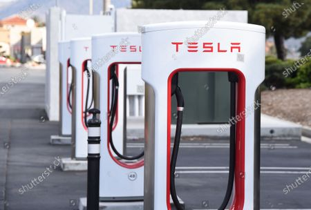 Tesla charging stations sit unused at retail stores at the outdoor mall Cabazon Outlets are open but largely empty due to Covid-19 Corona virus in Cabazon, California John Green/CSM
