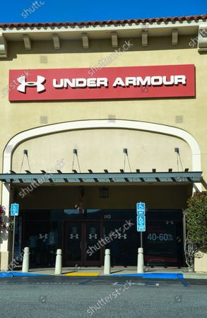 Closed Under Armour retail stores at the outdoor mall Cabazon Outlets are open but largely empty due to Covid-19 Corona virus in Cabazon, California John Green/CSM
