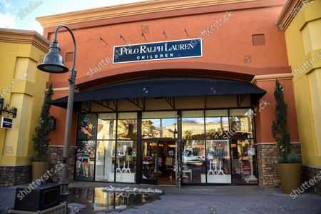 Few customers at the Polo Ralph Lauren Children retail stores at the outdoor mall Cabazon Outlets are open but largely empty due to Covid-19 Corona virus in Cabazon, California John Green/CSM