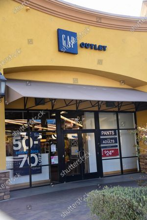 Few customers at The Gap retail stores at the outdoor mall Cabazon Outlets are open but largely empty due to Covid-19 Corona virus in Cabazon, California John Green/CSM
