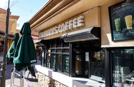 Few customers at the Starbucks Coffee stores at the outdoor mall Cabazon Outlets are open but largely empty due to Covid-19 Corona virus in Cabazon, California John Green/CSM