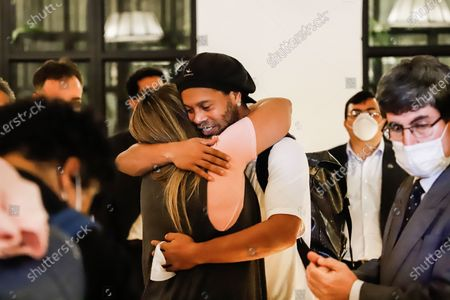 Brazilian former soccer player Ronaldinho Gaucho hugs a friend as he arrives at the Hotel Palmaroga in Asuncion, Paraguay, 07 April 2020. Ronaldinho and his brother entered the hotel to serve house arrest after leaving the police headquarters. The brothers remained in police custody for a month after being charged with entering Paraguay with fake passports and were released on a 1.6-million US dollar bail.
