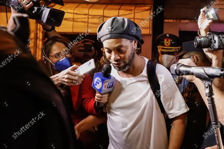 Brazilian former soccer player Ronaldinho Gaucho arrives at the Hotel Palmaroga in Asuncion, Paraguay, 07 April 2020. Ronaldinho and his brother entered the hotel to serve house arrest after leaving the police headquarters. The brothers remained in police custody for a month after being charged with entering Paraguay with fake passports and were released on a 1.6-million US dollar bail.