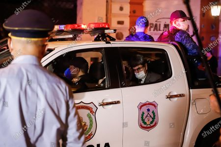 A police car carrying Brazilian former soccer player Ronaldinho Gaucho (not pictured) arrives at the Hotel Palmaroga in Asuncion, Paraguay, 07 April 2020. Ronaldinho and his brother entered the hotel to serve house arrest after leaving the police headquarters. The brothers remained in police custody for a month after being charged with entering Paraguay with fake passports and were released on a 1.6-million US dollar bail.