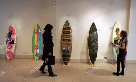 Auction Of Urban Art At Bonhams New Bond Street. Surfboards With Pattern Design By Artists L-r: Pure Evil Paul Mccartney Nick Walker Polly Morgan Mau Mau Picture By Glenn Copus
