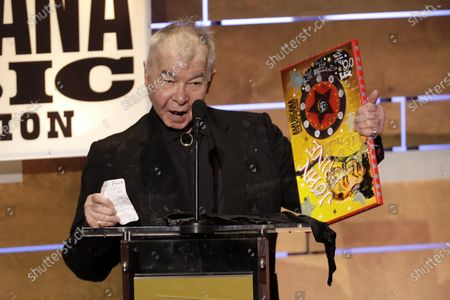 John Prine accepts the Album of the Year award at the Americana Honors & Awards show in Nashville, Tenn. Prine died, from complications of the coronavirus. He was 73