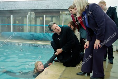 Ep 3148 Thursday 4th April 2002 Nicola uses the arrival of a group of travel agents to the holiday village a day early, to trick Maggie. Realising that she has been taken for a ride, Maggie sees red and attacks Nicola, pushing her into the village swimming pool. With Nicola Blackstock, as played by Nicola Wheeler ; Rodney Blackstock, as played by Patrick Mower ; Maggie Calder, as played by Dee Whitehead; Jess Weston, as played by Ruth Abram.