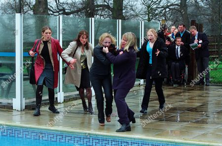 Stock Image of Ep 3148 Thursday 4th April 2002 Nicola uses the arrival of a group of travel agents to the holiday village a day early, to trick Maggie. Realising that she has been taken for a ride, Maggie sees red and attacks Nicola, pushing her into the village swimming pool. With Nicola Blackstock, as played by Nicola Wheeler ; Rodney Blackstock, as played by Patrick Mower ; Maggie Calder, as played by Dee Whitehead; Jess Weston, as played by Ruth Abram; Anne Marie Weston, as played by Tanya Myers ; Christopher Tate, as played by Peter Amory and others.