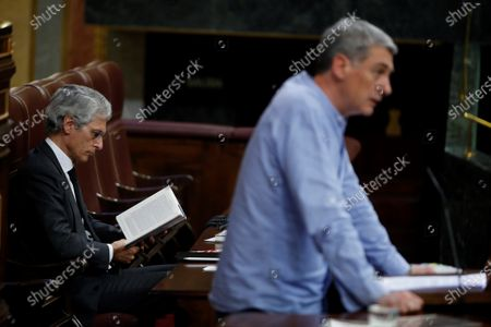 Lower Chamber's Board Secretary and conservative People's Party MP Adolfo Suarez Illana (R) reads a book as Basque pro-independent Bildu party's MP Oskar Matute (R) delivers a speech during the plenary session at Lower Chamber of Spanish Parliament, in Madrid, Spain, 09 April 2020. The session is to be focused in passing a new extension of the state of alarm due to coronavirus outbreak.
