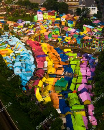 A run down village is transformed into a beautiful rainbow painting after locals covered the entire area in bright colours