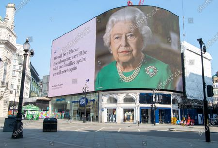 Queen Elizabeth II on a bilboard in Piccadilly Circus