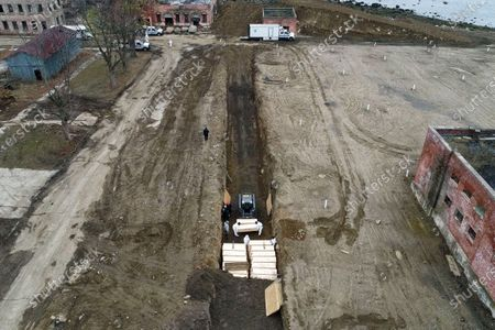 Workers wearing personal protective equipment bury bodies in a trench on Hart Island, in the Bronx borough of New York. New York City could bury virus victims in temporary graves if city morgues are overwhelmed. Mayor Bill DeBlasio said earlier in the week that officials have explored the possibility of temporary burials on Hart Island, a strip of land in Long Island Sound that has long served as the city's potter's field. The city's 2008 Pandemic Influenza Surge Plan states that Hart Island would be used as a temporary burial site in the event the death toll reaches the tens of thousands and if other storage, such as the refrigerator trucks parked outside hospitals, is full