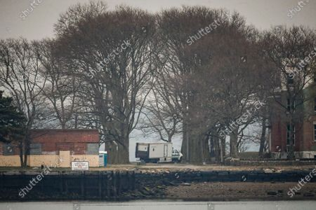 Truck loaded with bodies drives towards a burial trench on Hart Island, in the Bronx borough of New York. New York City could bury virus victims in temporary graves if city morgues are overwhelmed. Mayor Bill DeBlasio said earlier in the week that officials have explored the possibility of temporary burials on Hart Island, a strip of land in Long Island Sound that has long served as the city's potter's field. The city's 2008 Pandemic Influenza Surge Plan states that Hart Island would be used as a temporary burial site in the event the death toll reaches the tens of thousands and if other storage, such as the refrigerator trucks parked outside hospitals, is full