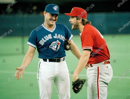 Toronto Blue Jays pitcher Duane Ward, left, has a laugh with Philadelphia Phillies pitcher Tommy Greene prior to start of Game 2 in the World Series at Skydome in Toronto. The Canadian Baseball Hall of Fame is posting its 2020 induction ceremony because of the COVID-19 pandemic. Former Toronto Blue Jays first baseman and two-time World Series champion John Olerud, 2006 American League MVP Justin Morneau, Ward and Montreal sportscaster Jacques Doucet were scheduled to be enshrined in a ceremony in St. Marys on June 20