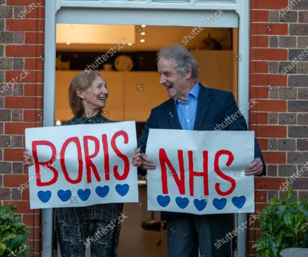 Recovering cancer patient Paul Morgan 76 and his wife Carolyn 84 from Wandsworth who have been self-isolating for 4 weeks clap for the NHS and Boris Johnson as millions of Brits around the country applaud the NHS and frontline workers this evening as Prime Minister Boris Johnson leaves ICU department at St Thomas's Hospital.