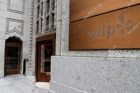 Stock Image of Yelp signage in front of their headquarters in San Francisco, California, USA, 09 April 2020. Yelp, the online review platform, announced it will be laying off or furloughing at least 2,000 employees. Jeremy Stoppelman, CEO and co-founder of Yelp explained in an email to its employees that the shelter-in-place order have led to a critical slowdown in the businesses essential to Yelp's review platform.