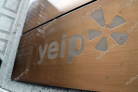 Yelp signage in front of their headquarters in San Francisco, California, USA, 09 April 2020. Yelp, the online review platform, announced it will be laying off or furloughing at least 2,000 employees. Jeremy Stoppelman, CEO and co-founder of Yelp explained in an email to its employees that the shelter-in-place order have led to a critical slowdown in the businesses essential to Yelp's review platform.
