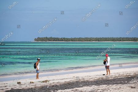 Two men walk at Bavaro beach in Punta Cana, Dominican Republic, 09 April 2020. The Dominican Government has warned that trips to the interior of the country are 'strictly prohibited' during the Easter holidays, a period in which thousands of people use to travel to beaches, rivers and other places of leisure. The Chamber of Deputies of the Dominican Republic authorized the extension of the state of emergency until 30 April, a shorter period than the one requested by the President, Danilo Medina.