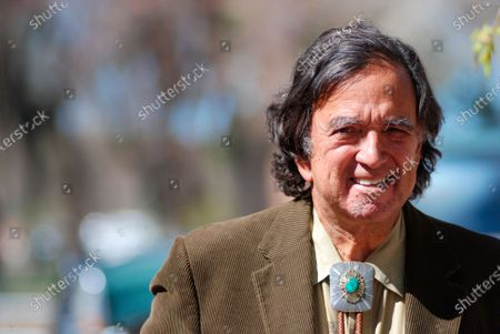 Former New Mexico Gov. Bill Richardson emerges from his office in Santa Fe, N.M., . Richardson is spearheading a charitable fund drive to help supply the Navajo Nation in New Mexico with personal protection and medical equipment to stem the spread of the coronavirus in cooperation with Molina Healthcare and the New Mexico Children's Foundation. Infections have surged on the Navajo Nation where there is limited access to everything from intensive care beds to surgical masks and household drinking water