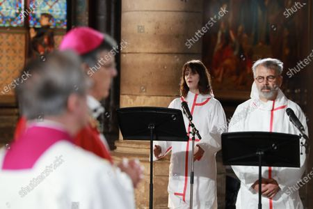 Stock Photo of (From L) Actor Judith Chemla performs next to actor Philippe Torreton as they attend a meditation ceremony to celebrate Good Friday in a secured part of Notre-Dame de Paris cathedral on April 10, 2020, in Paris on the 25th day of a strict lockdown aimed at curbing the spread of the COVID-19 pandemic, caused by the novel coronavirus. - Notre-Dame, part of a UNESCO world heritage site on the banks of the River Seine, was ravaged by the April 15 blaze -- losing its gothic spire, roof and many precious artefacts.