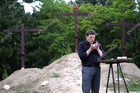 Senior Pastor Jason J. Nelson blows out a candle during a Good Friday livestream service outside Rose Hill United Methodist Church, in Tomball, Texas. The church has been broadcasting services during the COVID-19 outbreak