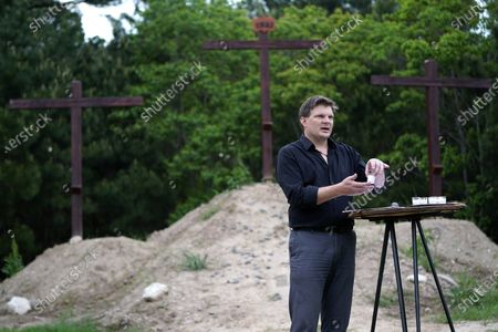 Senior Pastor Jason J. Nelson conducts a Good Friday livestream service outside Rose Hill United Methodist Church, in Tomball, Texas. The church has been broadcasting services during the COVID-19 outbreak