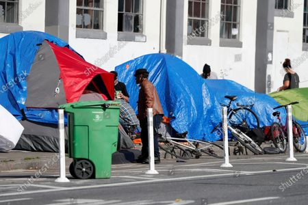 A view of a homeless encampment a block down the street from the St. Vincent De Paul Society Multi-Service Center South (MSC South) homeless shelter in San Francisco, California, USA, 10 April 2020. San Francisco Mayor London Breed confirmed an outbreak of 70 new positive coronavirus cases at its largest homeless shelter, MSC South. Sixty-eight homeless individuals and two staff members at the shelter tested positive. The shelter has a 340-bed capacity and is being transitioned from a homeless shelter to a medical care facility.