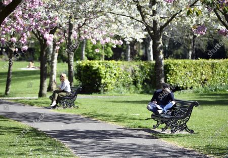 People relax in Herbert Park in Dublin, Ireland, 11 April 2020. Irish Prime Minister Leo Varadkar announced a further extension to the restrictions on movment due to the coronavirus Covid-19 pandemic until 11 May 2020.