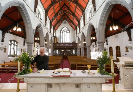 Father Tom Devlin prepares to celebrate Easter Sunday mass at at St Bridget's RC Church in the parish of St Ambrose in Baillieston, Glasgow, Scotland, 12 April 2020. Due to the Covid-19 pandemic he streamed the service live via Facebook to parishioners.