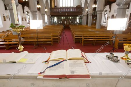 General view of an empty St Bridget's RC Church in the parish of St Ambrose in Baillieston, Glasgow, Scotland, 12 April 2020. Due to the Covid-19 pandemic Father Tom Devlin streamed the Easter Sunday service live via Facebook to parishioners.