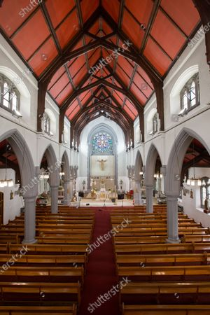 General view of an empty St Bridget's RC Church in the parish of St Ambrose in Baillieston, Glasgow, Scotland, 12 April 2020. Due to the Covid-19 pandemic Father Tom Devlin streamed the service live via Facebook to parishioners.