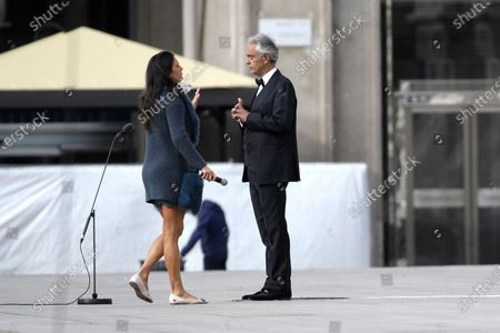Italian singer Andrea Bocelli talks with his wife Veronica Berti prior to performing outside the Duomo cathedral, on Easter Sunday, in Milan, Italy, . Bocelli was invited by Milan's Mayor Giuseppe Sala to perform an Easter concert inside an empty Duomo due to the lockdown measures to prevent the spread of Covid-19. The new coronavirus causes mild or moderate symptoms for most people, but for some, especially older adults and people with existing health problems, it can cause more severe illness or death