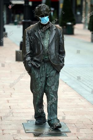 Oviedo, SPAIN: The statue of Woody Allen with a face mask during the 30th day of the State of Alarm in Spain, in Oviedo, Spain on April 12, 2020.