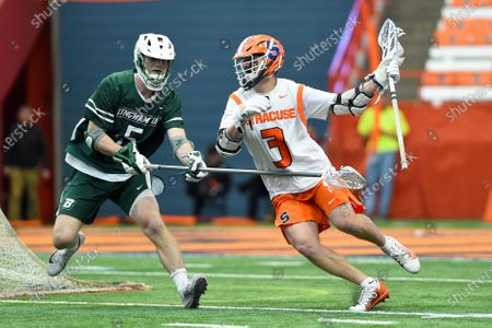 Syracuse Orange attackman Mikey Berkman #3 dodges to the goal as Binghamton Bearcats defenseman James Morris #5 defends during an NCAA mens lacrosse game on Saturday, Feb., 15, at the Carrier Dome in Syracuse, New York. Syracuse won 17-4
