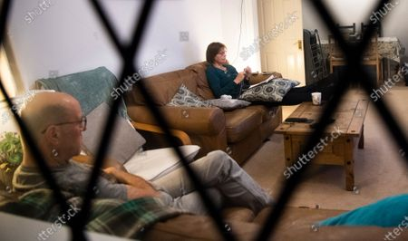 Hazel and Andrew watch TV in their living room in South London, Britain, 01 April 2020.  Not since the Second World War has Britain's way of life changed so dramatically. On 23 March, Prime Minister Boris Johnson announced the implementation of social distancing measures banning social gatherings and groups of more than two people, closing schools, most major sports and entertainment events in order to prevent the spread of the SARS-CoV-2 coronavirus causing the Covid-19 disease. The coronavirus has turned Britons lives upside down and, despite the huge challenges ordinary people are facing everyday, when the sun sets, families come together inside their homes.