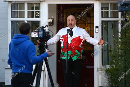 Wynne Evans hosts a live broadcast of The Welsh National Anthem on social media in appreciation of the NHS and all the care and key workers during the Covid19 coronavirus pandemic.